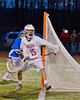 Baldwinsville Bees Daniel Thomas (15) makes a save against the Oswego Buccaneers in Section III Boys Lacrosse action in Fulton, New York on Thursday, May 1, 2014.  Baldwinsville won 13-9.