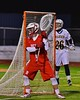 Baldwinsville Bees goalie Sean Coe (1) in net against the West Genesee Wildcats in Section III Boys Lacrosse action at Nottingham High School in Syracuse, New York on Tuesday, March 31, 2015. West Genesee won 14-8.