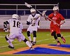 West Genesee Wildcats Grainer Sasso (16) scoops up a ground ball as Conor Bartlett (2) holds off Baldwinsville Bees Patrick Delpha (11) in Section III Boys Lacrosse action at Nottingham High School in Syracuse, New York on Tuesday, March 31, 2015. West Genesee won 14-8.