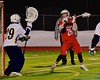 Baldwinsville Bees Connor Smith (26) winds up before scoring a goal past West Genesee Wildcats goalie Ryan Mavretish (29) in Section III Boys Lacrosse action at Nottingham High School in Syracuse, New York on Tuesday, March 31, 2015. West Genesee won 14-8.