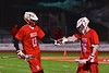 Baldwinsville Bees Peter Fiorni III (13) is congratulated for his goal against the West Genesee Wildcats by Connor Smith (26) in Section III Boys Lacrosse action at Nottingham High School in Syracuse, New York on Tuesday, March 31, 2015. West Genesee won 14-8.