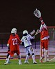Baldwinsville Bees goalie Sean Coe (1) makes a save on West Genesee Wildcats Nick Cunningham (3) in Section III Boys Lacrosse action at Nottingham High School in Syracuse, New York on Tuesday, March 31, 2015. West Genesee won 14-8.