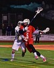 Baldwinsville Bees Charlie Bertrand (6) being defended by West Genesee Wildcats Jake McCarthy (31) in Section III Boys Lacrosse action at Nottingham High School in Syracuse, New York on Tuesday, March 31, 2015. West Genesee won 14-8.