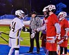 Baldwinsville Bees and West Genesee Wildcats captains shake hands after the coin toss in Section III Boys Lacrosse action at Nottingham High School in Syracuse, New York on Tuesday, March 31, 2015.