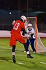 Baldwinsville Bees Peter Fiorni III (13) shoots and scores on West Genesee Wildcats goalie Ryan Mavretish (29) in Section III Boys Lacrosse action at Nottingham High School in Syracuse, New York on Tuesday, March 31, 2015. West Genesee won 14-8.