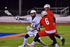 Baldwinsville Bees Charlie Bertrand (6) knocks the ball out of the stick of West Genesee Wildcats PJ Marinez (18) in Section III Boys Lacrosse action at Nottingham High School in Syracuse, New York on Tuesday, March 31, 2015. West Genesee won 14-8.