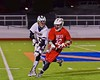 Baldwinsville Bees Evan Stolicker (32) being checked by West Genesee Wildcats Ryan McDonald (8) in Section III Boys Lacrosse action at Nottingham High School in Syracuse, New York on Tuesday, March 31, 2015. West Genesee won 14-8.
