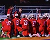 Baldwinsville Bees Head Coach Matt Wilcox talks with his team during halftime at Nottingham High School in Syracuse, New York on Tuesday, March 31, 2015. West Genesee won 14-8.