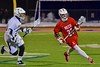 Baldwinsville Bees Jake Anderson (22) carrying the ball past West Genesee Wildcats Mike Fletcher (26) in Section III Boys Lacrosse action at Nottingham High School in Syracuse, New York on Tuesday, March 31, 2015. West Genesee won 14-8.