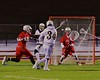 West Genesee Wildcats Ryan Smith (34) shoots and scores on Baldwinsville Bees goalie Sean Coe (1) in Section III Boys Lacrosse action at Nottingham High School in Syracuse, New York on Tuesday, March 31, 2015. West Genesee won 14-8.