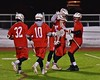 Baldwinsville Bees players congratulate Connor Smith (26) on his goal against the West Genesee Wildcats in Section III Boys Lacrosse action at Nottingham High School in Syracuse, New York on Tuesday, March 31, 2015. West Genesee won 14-8.