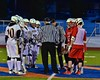 Game officials going over the rules before Baldwinsville Bees played the West Genesee Wildcats in Section III Boys Lacrosse action at Nottingham High School in Syracuse, New York on Tuesday, March 31, 2015.