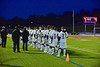 West Genesee Wildcats players standing for the National Anthem before playing the Baldwinsville Bees in Section III Boys Lacrosse action at Nottingham High School in Syracuse, New York on Tuesday, March 31, 2015.