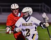 West Genesee Wildcats Conor Bartlett (2) being defended by Baldwinsville Bees Patrick Delpha (11) in Section III Boys Lacrosse action at Nottingham High School in Syracuse, New York on Tuesday, March 31, 2015. West Genesee won 14-8.