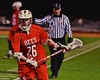 Baldwinsville Bees Connor Smith (26) carrying the ball against the West Genesee Wildcats in Section III Boys Lacrosse action at Nottingham High School in Syracuse, New York on Tuesday, March 31, 2015. West Genesee won 14-8.