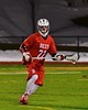 Baldwinsville Bees Jake Anderson (22) looking to make a play against the West Genesee Wildcats in Section III Boys Lacrosse action at Nottingham High School in Syracuse, New York on Tuesday, March 31, 2015. West Genesee won 14-8.