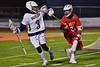 Baldwinsville Bees Ryan Kohutanich (23) defending against West Genesee Wildcats Nick Cunningham (3) in Section III Boys Lacrosse action at Nottingham High School in Syracuse, New York on Tuesday, March 31, 2015. West Genesee won 14-8.