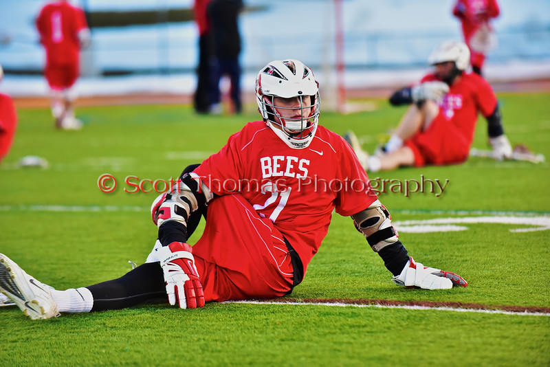 Baldwinsville Bees Eric Klein (21) stretching out before playing the West Genesee Wildcats in Section III Boys Lacrosse action at Nottingham High School in Syracuse, New York on Tuesday, March 31, 2015.