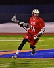 Baldwinsville Bees Matthew Dickman (24) with the ball against the West Genesee Wildcats in Section III Boys Lacrosse action at Nottingham High School in Syracuse, New York on Tuesday, March 31, 2015. West Genesee won 14-8.