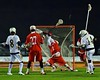 West Genesee Wildcats David Procopio (14) scores past Baldwinsville Bees goalie Sean Coe (1) in Section III Boys Lacrosse action at Nottingham High School in Syracuse, New York on Tuesday, March 31, 2015. West Genesee won 14-8.