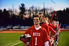Baldwinsville Bees players standing for the National Anthem before playing the West Genesee Wildcats in Section III Boys Lacrosse action at Nottingham High School in Syracuse, New York on Tuesday, March 31, 2015.