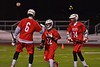 Baldwinsville Bees players Charlie Bertrand (6) and Matthew Dickman (24) congratulate Jake Anderson (22) on his goal against the West Genesee Wildcats in Section III Boys Lacrosse action at Nottingham High School in Syracuse, New York on Tuesday, March 31, 2015. West Genesee won 14-8.