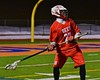 Baldwinsville Bees David Gullen (27) about to pass the ball upfield against the West Genesee Wildcats in Section III Boys Lacrosse action at Nottingham High School in Syracuse, New York on Tuesday, March 31, 2015. West Genesee won 14-8.