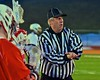 Referee flips a coin before the Baldwinsville Bees played the West Genesee Wildcats in Section III Boys Lacrosse action at Nottingham High School in Syracuse, New York on Tuesday, March 31, 2015.