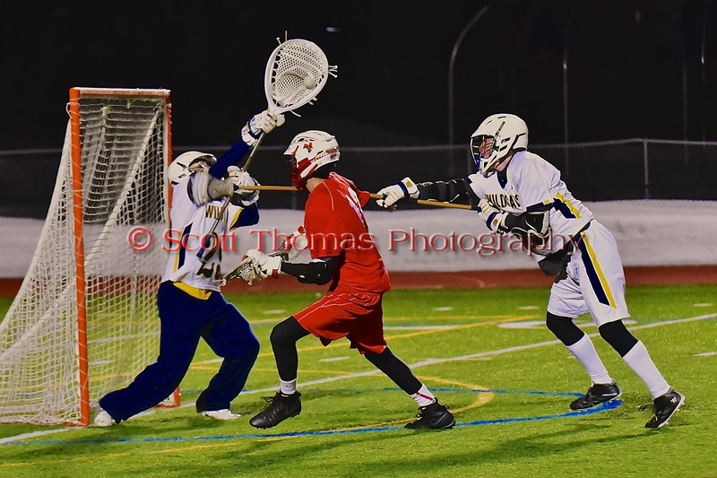 West Genesee Wildcats goalie Ryan Mavretish (29) makes a save on Baldwinsville Bees Peter Fiorni III (13) in Section III Boys Lacrosse action at Nottingham High School in Syracuse, New York on Tuesday, March 31, 2015. West Genesee won 14-8.