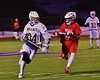 West Genesee Wildcats Ryan Smith (34) with the ball against Baldwinsville Bees Jake Anderson (22) in Section III Boys Lacrosse action at Nottingham High School in Syracuse, New York on Tuesday, March 31, 2015. West Genesee won 14-8.