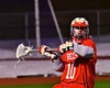 Baldwinsville Bees Dillon Darcangelo (10) looking to pass the ball against the West Genesee Wildcats in Section III Boys Lacrosse action at Nottingham High School in Syracuse, New York on Tuesday, March 31, 2015. West Genesee won 14-8.