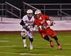 Baldwinsville Bees Patrick Delpha (11) protecting the ball from a West Genesee Wildcats player in Section III Boys Lacrosse action at Nottingham High School in Syracuse, New York on Tuesday, March 31, 2015. West Genesee won 14-8.