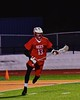 Baldwinsville Bees Peter Fiorni III (13) looking to make a play against the West Genesee Wildcats in Section III Boys Lacrosse action at Nottingham High School in Syracuse, New York on Tuesday, March 31, 2015. West Genesee won 14-8.
