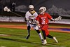 Baldwinsville Bees Connor Smith (26) makes a run past West Genesee Wildcats defencemen Jake McCarthy (31) in Section III Boys Lacrosse action at Nottingham High School in Syracuse, New York on Tuesday, March 31, 2015. West Genesee won 14-8.