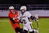 Baldwinsville Bees Patrick Delpha (11) checks West Genesee Wildcats Conor Bartlett (2) in Section III Boys Lacrosse action at Nottingham High School in Syracuse, New York on Tuesday, March 31, 2015. West Genesee won 14-8.