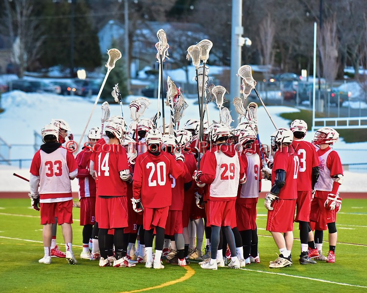 Baldwinsville Bees huddle up before playing the West Genesee Wildcats in Section III Boys Lacrosse action at Nottingham High School in Syracuse, New York on Tuesday, March 31, 2015.