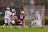 Baldwinsville Bees goalie Riley Smith (35) makes a save on a shot by Auburn Maroons Brian Cunningham (16) in Section III Boys Lacrosse action at the Pelcher-Arcaro Stadium in Baldwinsville, New York on Monday, April 27, 2015..  Auburn won 14-10.