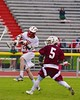 Baldwinsville Bees Matthew Dickman (24) shoots and scores against the Auburn Maroons in Section III Boys Lacrosse action at the Pelcher-Arcaro Stadium in Baldwinsville, New York on Monday, April 27, 2015..  Auburn won 14-10.