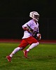 Baldwinsville Bees Jake Anderson (22) with the ball against the Cicero-North Syracuse Northstars in Section III Boys Lacrosse action at the Pelcher-Arcaro Stadium in Baldwinsville, New York on Tuesday, May 12, 2015.  Baldwinsville won 7-4.