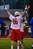 Baldwinsville Bees Connor Smith (26) celebrates his goal against the Cicero-North Syracuse Northstars in Section III Boys Lacrosse action at the Pelcher-Arcaro Stadium in Baldwinsville, New York on Tuesday, May 12, 2015.  Baldwinsville won 7-4.