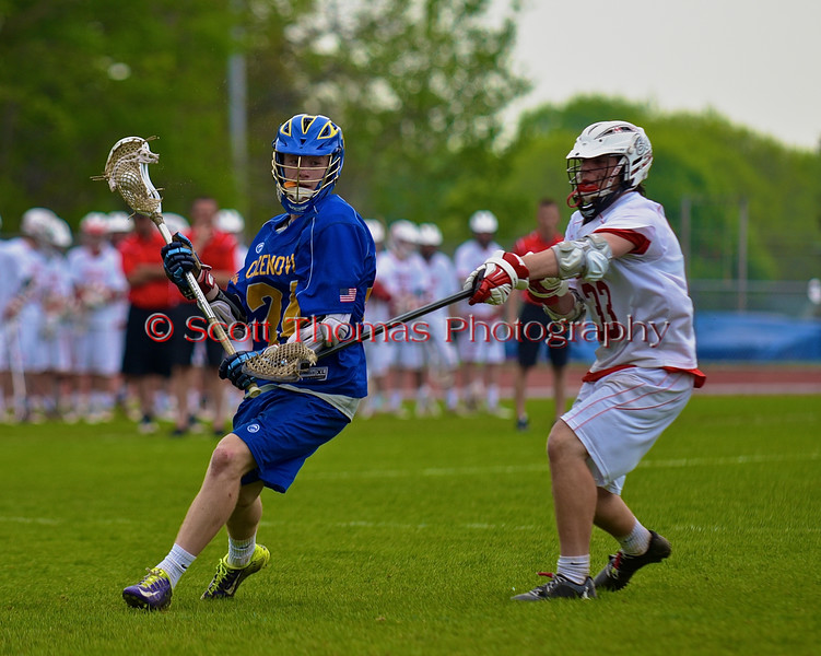 Baldwinsville Bees John Petrelli (33) stick checking Cazenovia Lakers Cole Willard (24) in Section III Boys Lacrosse action at the Pelcher-Arcaro Stadium in Baldwinsville, New York on Saturday, May 9, 2015.  Cazenovia won 13-6.