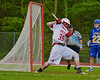 Baldwinsville Bees goalie Riley Smith (35) makes a save on a shot by Cazenovia Lakers Jake Lewis (26, not pictured) in Section III Boys Lacrosse action at the Pelcher-Arcaro Stadium in Baldwinsville, New York on Saturday, May 9, 2015.  Cazenovia won 13-6.
