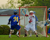Cazenovia Lakers Derek White (31) fires in a goal past Baldwinsville Bees goalie Riley Smith (35) in Section III Boys Lacrosse action at the Pelcher-Arcaro Stadium in Baldwinsville, New York on Saturday, May 9, 2015..  Cazenovia won 13-6.