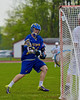 Cazenovia Lakers Cole Willard (24) fires in a goal against the Baldwinsville Bees in Section III Boys Lacrosse action at the Pelcher-Arcaro Stadium in Baldwinsville, New York on Saturday, May 9, 2015.  Cazenovia won 13-6.