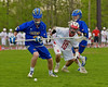 Baldwinsville Bees Dillon Darcangelo (10) and Cazenovia Lakers Adam Race (2) go after a ground ball in Section III Boys Lacrosse action at the Pelcher-Arcaro Stadium in Baldwinsville, New York on Saturday, May 9, 2015.  Cazenovia won 13-6.
