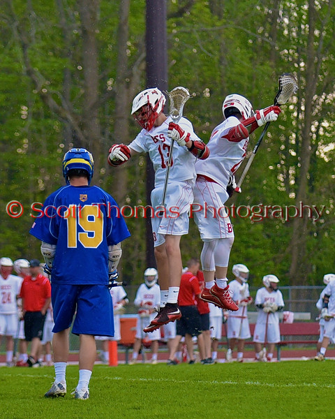 Baldwinsville Bees Peter Fiorni III (13) and Jake Anderson (22) celebrate a goal against the Cazenovia Lakers in Section III Boys Lacrosse action at the Pelcher-Arcaro Stadium in Baldwinsville, New York on Saturday, May 9, 2015.  Cazenovia won 13-6.