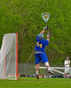 Cazenovia Lakers goalie Brenden Whalen (21) jumps to get a rebound against the Baldwinsville Bees in Section III Boys Lacrosse action at the Pelcher-Arcaro Stadium in Baldwinsville, New York on Saturday, May 9, 2015.  Cazenovia won 13-6.