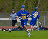 Cazenovia Lakers Alex Hunt (22) with the ball against the Baldwinsville Bees in Section III Boys Lacrosse action at the Pelcher-Arcaro Stadium in Baldwinsville, New York on Saturday, May 9, 2015.  Cazenovia won 13-6.