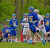 Cazenovia Lakers Chris Becker (12) with the ball against the Baldwinsville Bees in Section III Boys Lacrosse action at the Pelcher-Arcaro Stadium in Baldwinsville, New York on Saturday, May 9, 2015.  Cazenovia won 13-6.