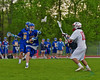 Baldwinsville Bees Dillon Darcangelo (10) passing the ball against the Cazenovia Lakers in Section III Boys Lacrosse action at the Pelcher-Arcaro Stadium in Baldwinsville, New York on Saturday, May 9, 2015.  Cazenovia won 13-6.